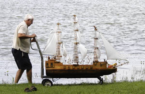 Pete Matejka of Mount Dora sails his model square rigged ship on Lake Dora in July in Mount Dora.