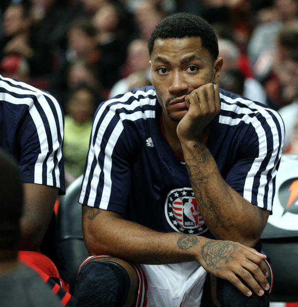 Bulls point guard Derrick Rose sits on the bench in the fourth quarter of a blowout win Friday over Utah.