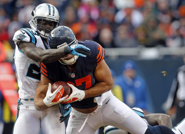 Then-Bears tight end Kellen Davis (87) catches a touchdown in front of Carolina Panthers free safety Sherrod Martin (23) in the fourth quarter Sunday, Oct. 28, 2012.