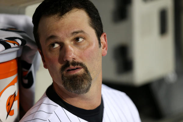 Chicago White Sox first baseman Paul Konerko (14) sits in the dugout before the start of a game against the Kansas City Royals at U.S. Cellular Field in late September.