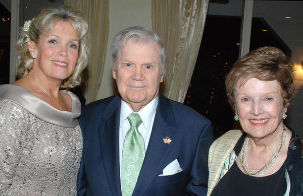 "Actor Bob Hastings, best-known for roles on ""McHale's Navy"" and ""All in the Family,"" flanked by his wife, Joan and daughter-in-law, Kathy Hastings, at last week's Harvest Ball."