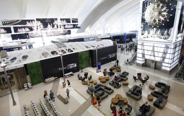 A new survey says passenger spending on food, drink and retail items is up at U.S. airports. Here, multimedia displays entertain passengers at the recently ugpraded and expanded Bradley International Terminal at LAX.