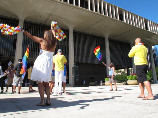Supporters of gay marriage rally outside the Hawaii Capitol in Honolulu ahead of a Senate vote on whether to legalize same-sex marriage.