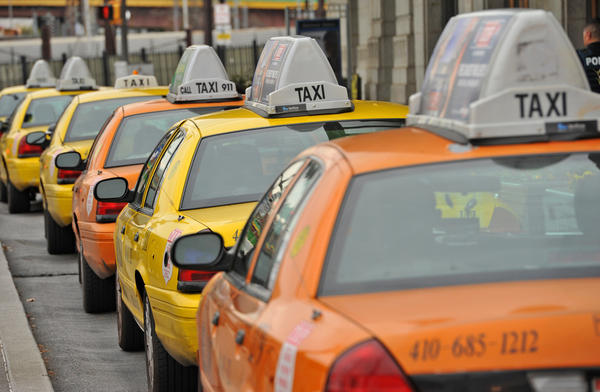 Taxis lined up outside of Penn Station. A group of taxi, limo, and sedan-for-hire services say they will refuse to pay a new city tax on taxi trips in the city, which went into effect on Oct. 1. T