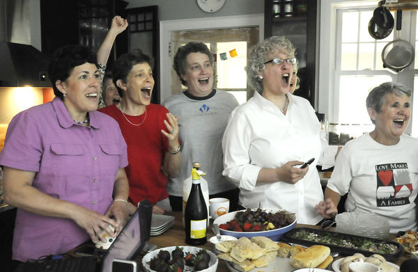 Gathered in a kitchen of a West Hartford home, couples and friends celebrate minutes after 10 a.m., when the U.S. Supreme Court overturned the Defense of Marriage Act. From left are Carol Buckheit, Tracy Wilson and her wife, state Sen. Beth Bye, Jamie Mills and Beth Kerrigan.