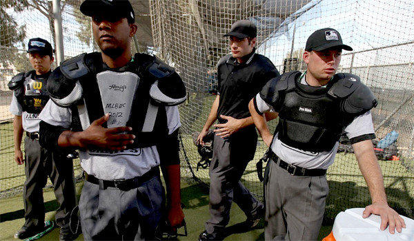 Baseball umpire trainees prepare to learn the basics of calling balls and strikes in a batting cage at Compton Community College in Compton on Nov. 7.