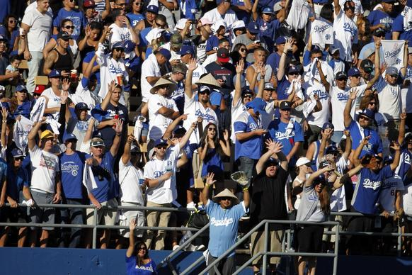 Dodgers fans are on their feet in the eighth inning of Game 5 on Wednesday afternoon.