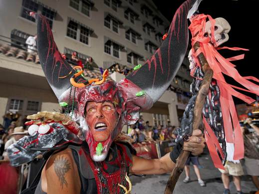 A costumed reveler participates in the Fantasy Fest Parade down Duval Street in Key West, Florida in this October 26, 2013 handout photo by Florida Keys News Bureau. The procession was the highlight event of the 10-day Fantasy Fest costuming and masking festival, attracting some 60,000 people, according to organizers.