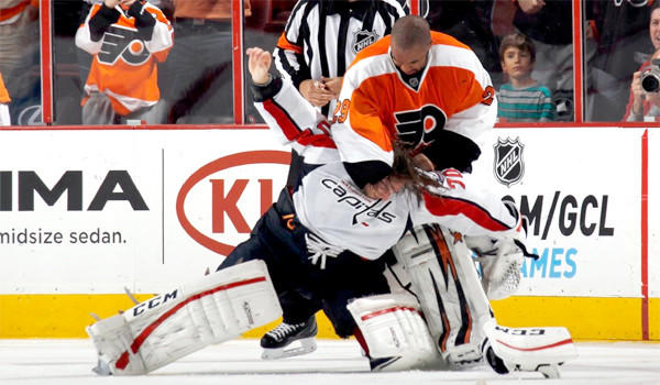 Philadelphia Flyers goalie Ray Emery and Washington Capitals goaltender Braden Holtby fight during the third period of a Nov. 1 game. Emery, who crossed the length of the ice to instigate the fight, was not suspended for his actions.
