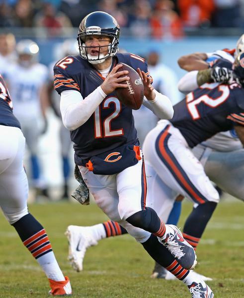 Chicago Bears quarterback Josh McCown looks for a receiver against the Detroit Lions.