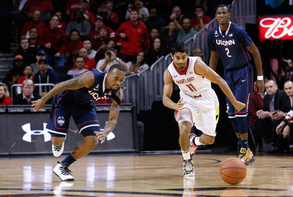 Maryland's Varun Ram (River Hill) and Connecticut's Ryan Boatright chase down a loose ball at Barclays Center.