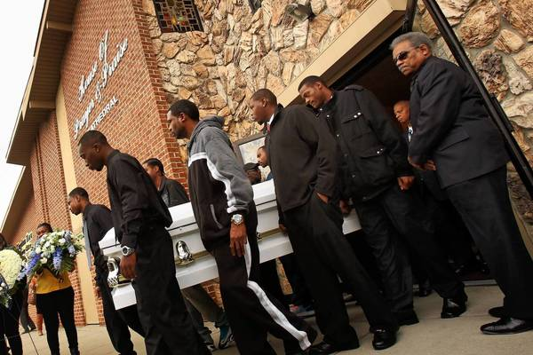 Pallbearers carry the coffin of 19-year-old Renisha McBride after her funeral service in Detroit on Friday.