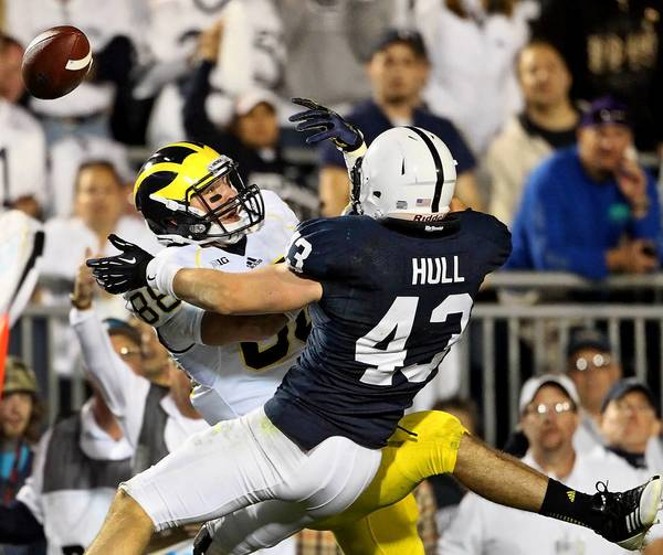 Penn State linebacker Mike Hull (43) knocks a pass away in the endzone from Michigan tight end Jake Butt (88) during overtime action at Beaver Stadium on Saturday, October 12, 2013.