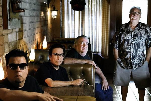 Los Lobos from left, Cesar Rosas, Louie Perez, David Hidalgo, and Conrad Lozano relax at Lucy's El Adobe Restaurant in Los Angeles.