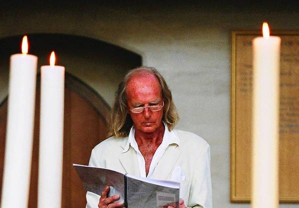"John Tavener reads the score of ""The Veil of the Temple"" during rehearsals."