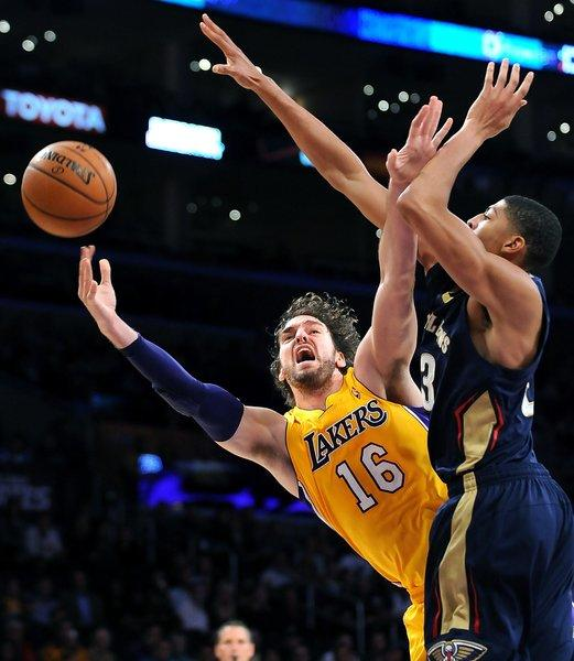 Pau Gasol shoots around New Orleans' Anthony Davis during the first half at Staples Center on Tuesday.