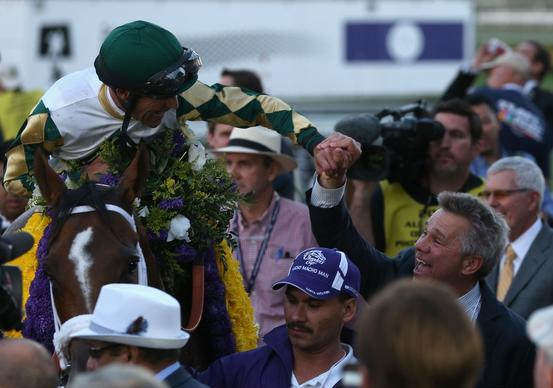 Jockey Gary Stevens celebrates atop Mucho Macho Man after winning the Breeders' Cup Classic on Saturday at Santa Anita Park.