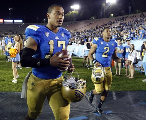 Quarterback Brett Hundley leaves the field with UCLA teammates after passing for 273 yards and two touchdowns while rushing for 72 yards and two more scores in a 45-23 victory over Colorado on Saturday night at the Rose Bowl.