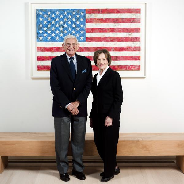 Philanthropists Eli and Edythe Broad are photographed in their Los Angeles home with an original Jasper Johns piece.