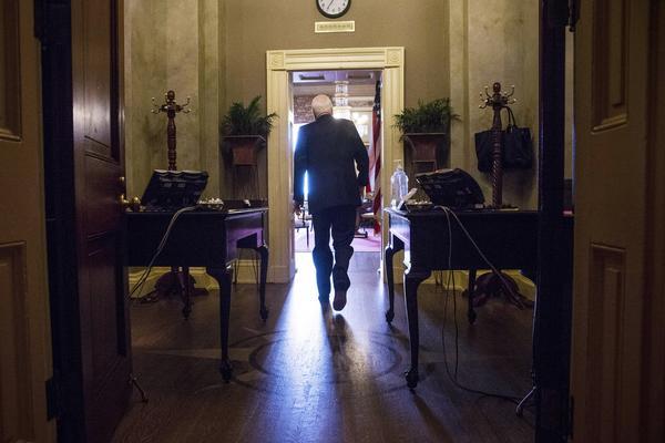 Sen. John McCain (R-Ariz.) arrives at a meeting on Capitol Hill.
