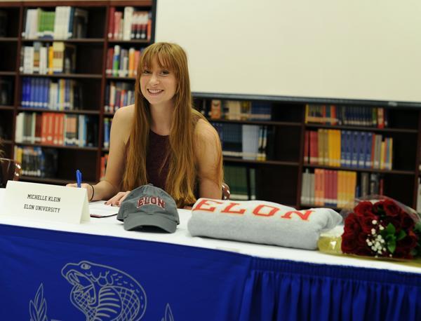 Park Vista volleyball player Michelle Klein signs with Elon University.