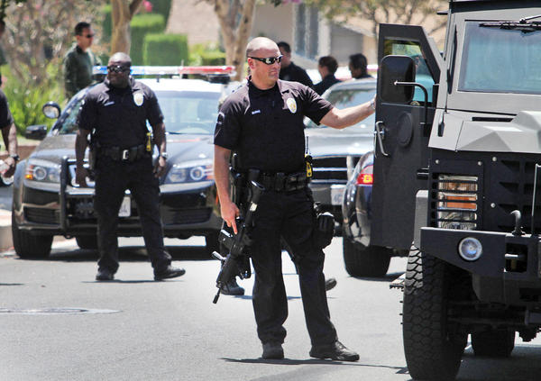 Burbank Police Officers stand down following a search for burglary suspects on Irving Dr. on Tuesday, August 20, 2013. An audit reviewed 13 use-of-force cases, eight internal affairs investigations and three car chases.