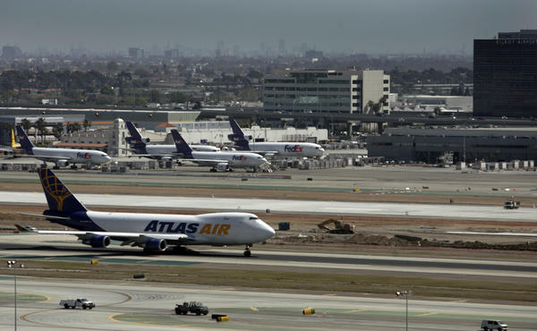 Aircraft operate on the reconfigured south runway complex at LAX, which is now the focus of a lawsuit over construction defects.