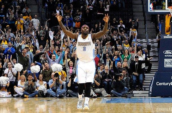 Nuggets point guard Ty Lawson celebrates a three-point basket against the Atlanta Hawks during the fourth quarter.