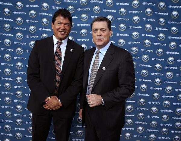 New Buffalo Coach Ted Nolan and president of hockey operations Pat LaFontaine pose for photos at a news conference Wednesday.