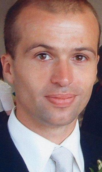 """Gareth Wyn Williams, the MI6 intelligence worker whose naked and decomposing body was found in August 2010 stuffed into a zipped and padlocked gym bag. Scotland Yard on Wednesday revised his suspected cause of death from """"unlawful"""" killing to likely the result of an accident that occurred when he was alone."""