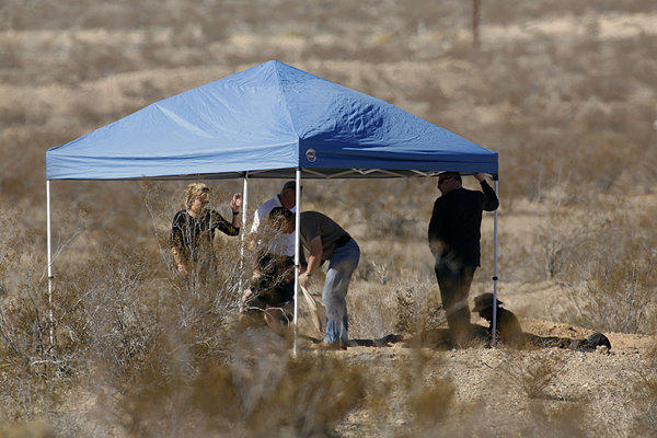 San Bernardino County Sheriff's Department investigators excavate a grave on the outskirts of Victorville that contained the skeletal remains of multiple people.