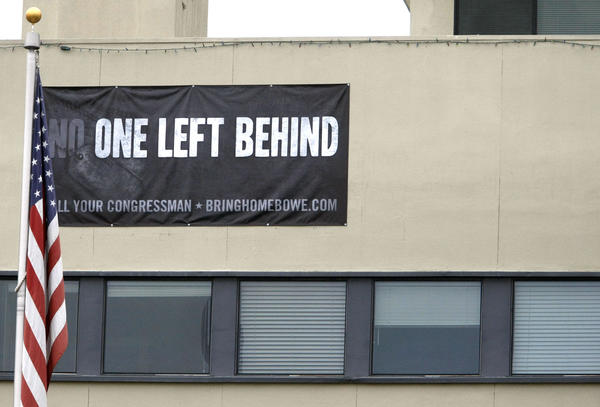 "A banner with ""No One Left Behind"" is placed high above on the Allen Lund Co. building on Angeles Crest Highway in La Cañada Flintridge, shown on Tuesday, Nov. 12, 2013."