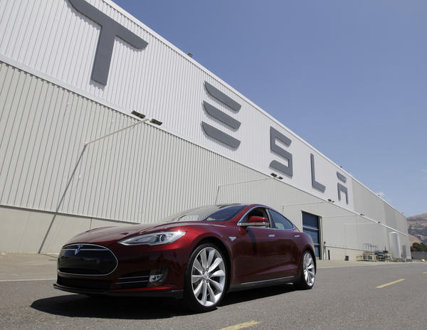 A file photo shows a Tesla Model S outside Tesla's factory in Fremont, Calif., where the company said three workers were hurt as a result of an equipment malfunction.