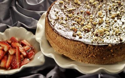 Chocolate-glazed nut torte with strawberries in Sephardi syrup