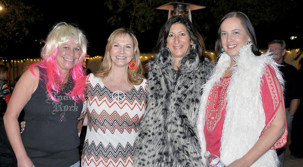 Ladies dressed up for 'Rockin' Out' are Jenny Painter, from left, Vicki Schwartz, Renee LaBran and Elysa Del Guercio.