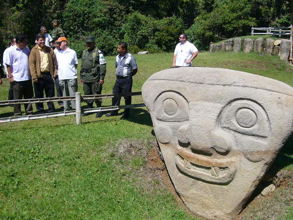 People gather near a statue in the San Agustin archaeological park in southern Colombia. Residents blocked the removal of 20 statues that were to have been displayed in a show in Bogota, the capital, causing the exhibit's cancellation.