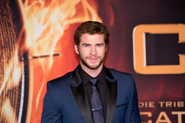 "Liam Hemsworth of ""The Hunger Games: Catching Fire"" says he's happy for all of ex-fiancee Miley Cyrus' success."