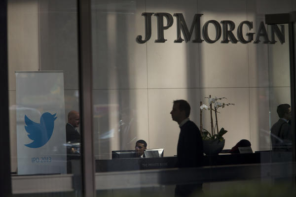 A man walks past the Twitter logo displayed in the lobby of JPMorgan Chase & Co. headquarters in New York last month. A planned Twitter chat backfired badly on JPMorgan.