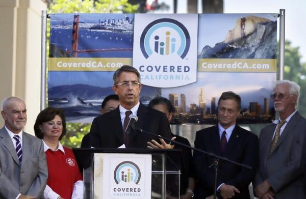 Officials at the October 1st launch of Covered California. One group involved in enrollment efforts said Wednesday that it always expected sign ups would be a slow process.