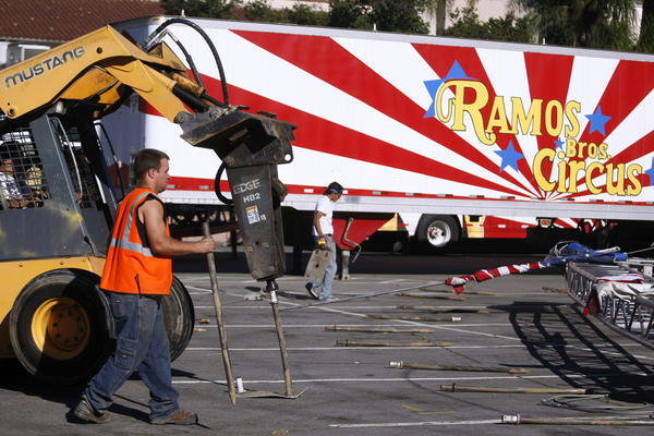 Workers prepare to raise the structure for the Ramos Bros. Circus at the Civic Auditorium parking lot in Glendale on Wednesday, Nov. 13, 2013.