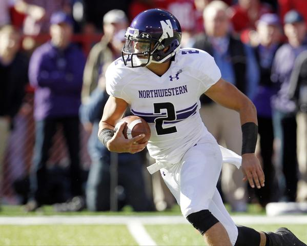 Northwestern quarterback Kain Colter runs against Nebraska.