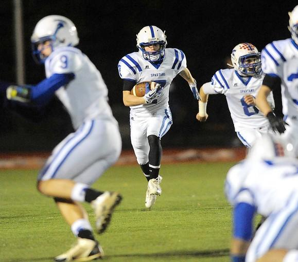 Southern Lehigh's Trent Silfies (center) looks for room to run during a kick off return against Palisades High School during their Colonial League high school football game.