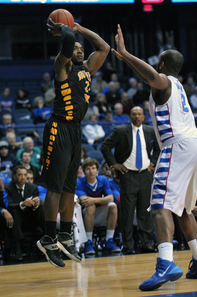 Southern Miss' Michael Craig shoots the ball against Tommy Hamilton IV during the first half.