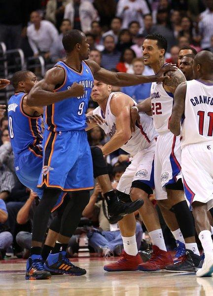 Oklahoma's Serge Ibaka and Matt Barnes square off during an altercation after a play before the end of the first half Wednesday at Staples Center. Ibaka and Barnes were both ejected.