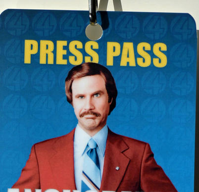 A press credential for a media tour shows actor Will Ferrell playing the character Ron Burgundy. The exhibit at the Washington museum opens to the public Thursday. The movie opens Dec. 20.