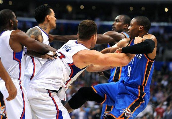 Blake Griffin pushes Russell Westbrook as Matt Barnes and Serge Ibaka tangle just before the end of the first half Wednesday at Staples Center.