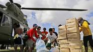 China increases aid to Philippines after drawing fire