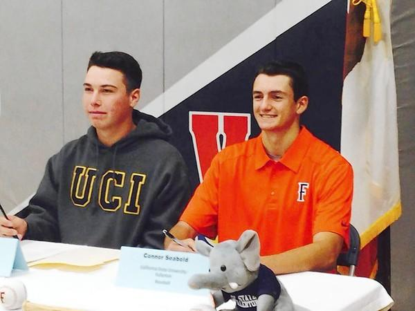 Newport Harbor High seniors Shaun Vetrovec, left, and Connor Seabold signed with UC Irvine and Cal State Fullerton, respectively, to play baseball.