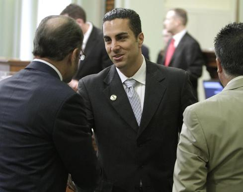 Mike Gatto (D-Silver Lake)receives congratulations after he was sworn in to the Assembly in 2010.