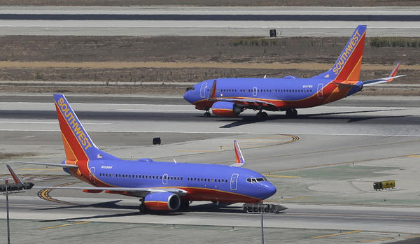 Southwest Airlines Boeing 737s at Los Angeles International Airport. The FAA is investigating what passengers on a Southwest Airlines flight described as a scary dive before the plane and made a normal landing at Raleigh-Durham International Airport.